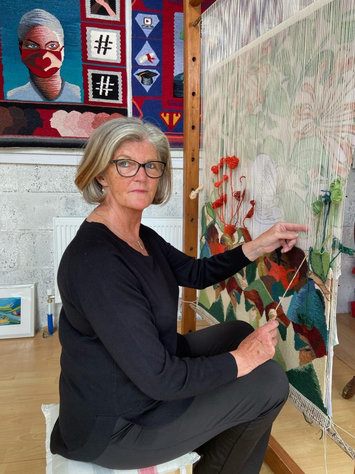 Frances Crowe weaving Love in a Pandemic